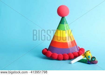 Party Cap And Blowers On Light Blue Background, Space For Text