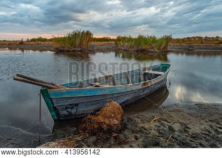 Old Wooden Fisherman's Boat On The Lake. Autumn Landscape. Traditional Homemade Wooden Boat With A F