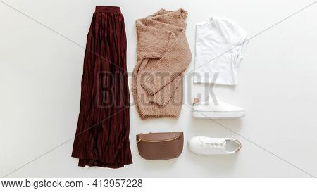 Female Spring Look Autumn Outfit Burgundy Skirt Beige Sweater White Shoes Sneakers Bag White Basic T