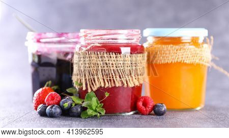 assorted of jam and berry fruit