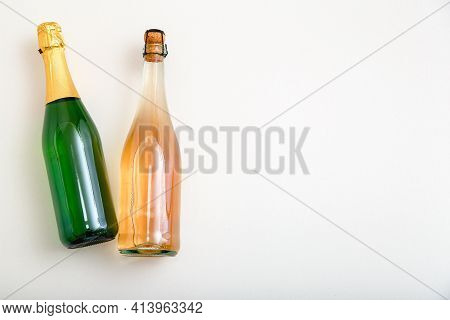 Rose Sparkling Wine Bottle And White Sparkling Wine In Green Bottle. Minimalistic Wine Composition T