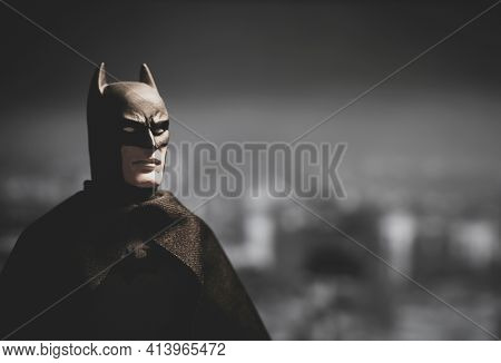 MARCH 23 2021: DC comics superhero Batman overlooking Gotham City at night - Mego Corporation action figure
