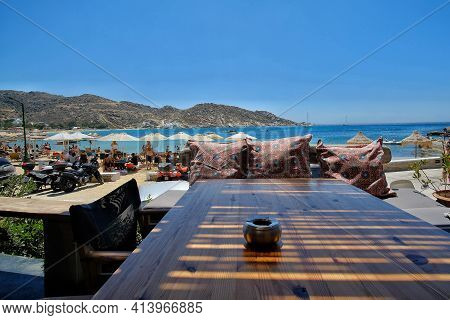 Ios, Greece - August 6, 2019 : Panoramic View Of The Mylopotas Beach In Ios Greece From A Beach Bar