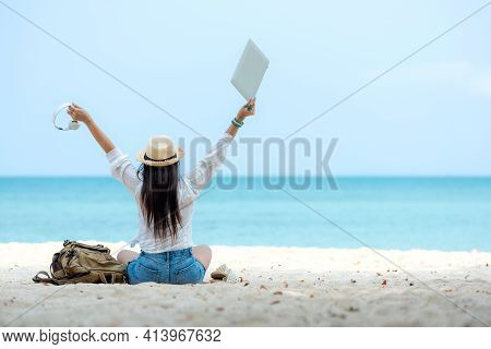 Lifestyle Freelance Woman Using Laptop Working And Relax On The Beach. Asia People Success And Toge