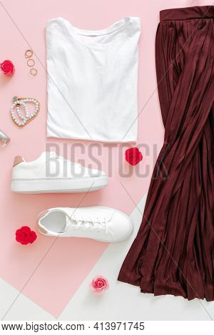 Female Spring Look Summer Outfit Skirt Shoes Sneakers Basic Tshirt Bag. Folded Clothes For Women Fas