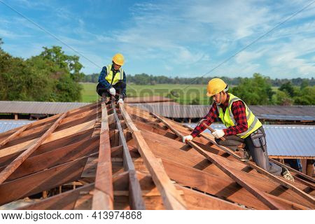 Roofer, Two Worker Roofer Builder Working On Roof Structure On Construction Site, Teamwork Construct