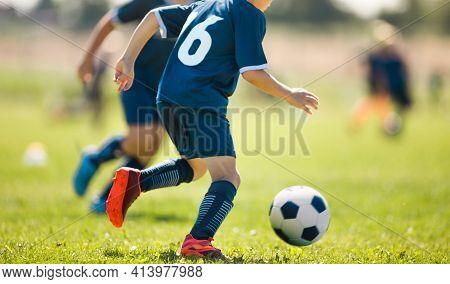 Boy Running Soccer Ball On Grass Field. Child In Soccer Sportswear Kicking Football Game. Soccer Tra