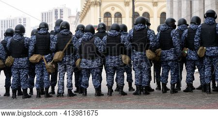 Moscow, Russia - January 31, 2021: Russian Riot Police Officers Stand In A Cordon On Unauthorized Po