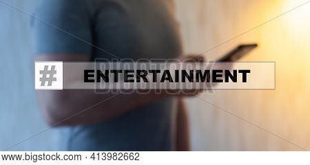 Entertainment In The Search Hologram. A Man Is Looking For Entertainment On The Internet On A Smartp