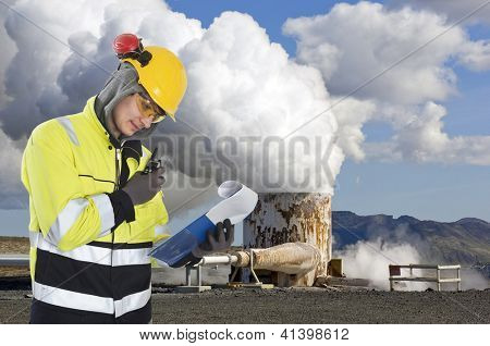 Geothermal engineer and geologist reading data from a list at a gothermal power plant in Iceland, creating hot water and sustainable energy from natural resources poster