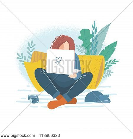 The Girl With The Laptop Sat Comfortably On The Sofa Among The Pillows. Young Woman Working From Hom