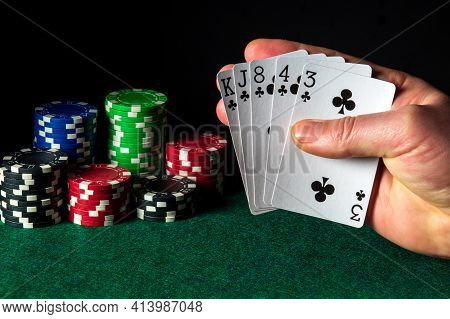 Poker Cards With Flush Combination. Close-up Of A Gambler Hand Is Holding Playing Cards In Casino. C