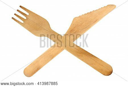 Environmentally Friendly Single Use Wooden Cutlery Including Knife And Fork Crossed Isolated On A Wh