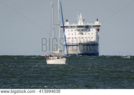 Swinoujscie, West Pomeranian - Poland -2020: Sailing Boat And Passenger Ferry On The Waterway