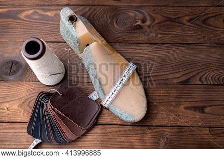 Leather Samples For Shoes And Wooden Shoe Last On Dark Wooden Table. Designer Furniture Clothes. Sho