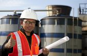 engineer oil refinery with storage tank background poster