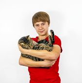 boy hugging with his cute tiger cat poster