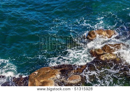 Seagul Watch The Waves And Splashes Around Hewn Smooth Sea Stones