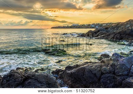Sunrise Near Sea With Crashing Waves On The Earth Edge