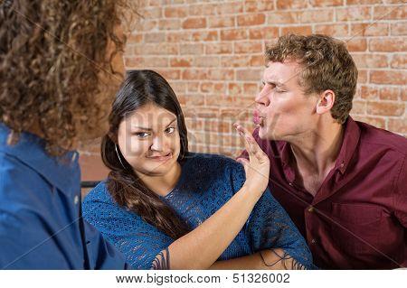 Woman Pushing Away Man
