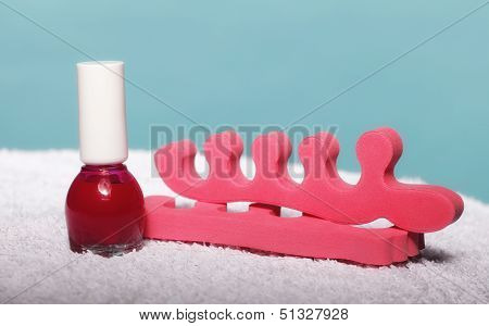 Foot Pedicure Red Nail Polish And Toe Separators
