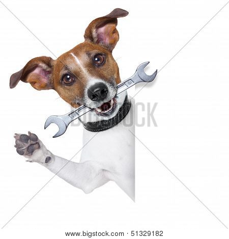 craftsman dog with spanner wrench in mouth beside a white blank banner poster