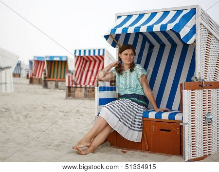 Young Happy Woman On The Beach Of St.peter Ording, North Sea,