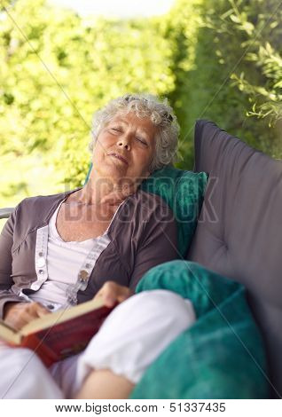 Elder Woman Sleeping In Backyard