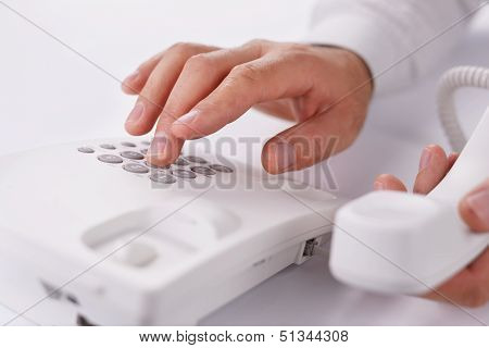 Man Making A Telephone Call On A Landline