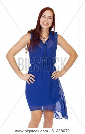 Beautiful Woman With Red Hair Smiles With Her Hands On Her Hips.
