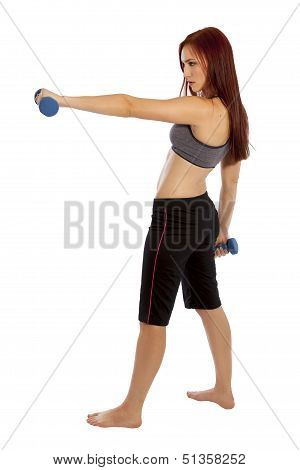 Young Woman Uses Hand Weights To Work Her Shoulders.