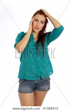 Young Woman With A Migraine Head Ache.
