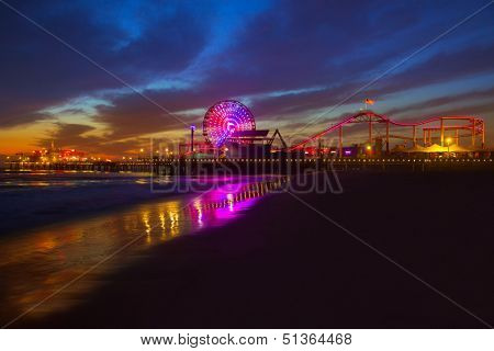 Santa Monica California sunset on Pier Ferrys wheel and reflection on beach wet sand