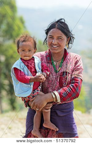 NAGARKOT, NEPAL - APRIL 5: Portrait of unidentified Nepalese family (mother with infant daughter) on April 5, 2009 in Nagarkot Village, Kathmandu, Central Region, Nepal.