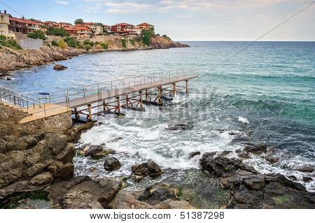 Metal Pier In Old Town On The Rocky Shore Near