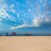 Huntington beach Pier Surf City USA with lifeguard tower in California poster