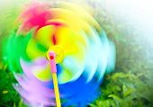 Colored spinning fun toy propeller in motion poster