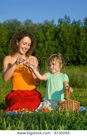 Pretty Little Girl And Young Women Keeps In Hand Sweet Cherries