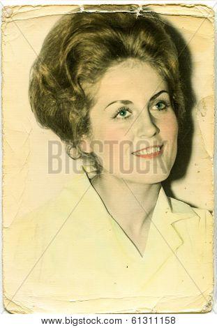 LODZ, POLAND - CIRCA 1960's: Vintage portrait of woman (manually colored)