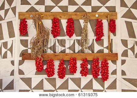 tomatoes hanging on decorated wall, Greece