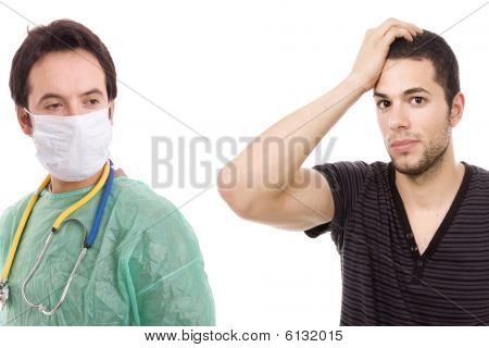 A Doctor And A Young Man In Agony Whith A Headache