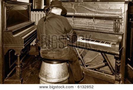 old time piano player in a saloon