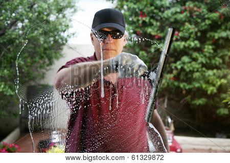 A friendly and professional a window washer soaps and cleans a window with a squeegee, leaving them Squeaky Clean. Everyone Loves Clean Windows especially in the Spring and Summer Season.