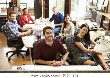 Portrait Of Office Staff At Table In Architect's Office