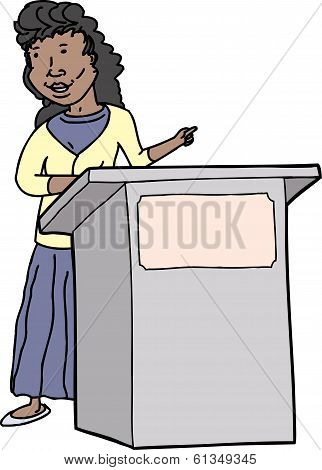 Woman Speaking At Lectern