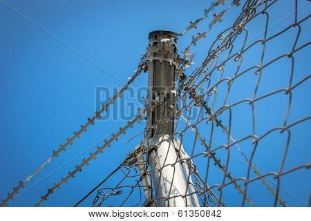 Dangerous barbed wire fence