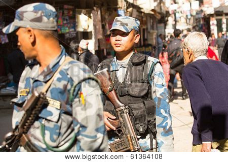 KATHMANDU, NEPAL - NOV 29, 2013: Soldiers during protest within a campaign to end violence against women (VAW). Held annually since 1991, 16 days Nov 25 - Dec 10.