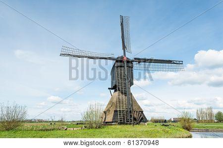 Old Windmill In A Dutch Polder