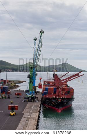 Cargo ship unloading containers