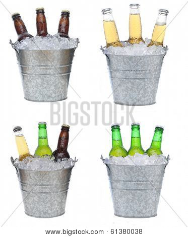 Four buckets holding three each of different beer bottles in ice. The bottles are covered with condensation and isolated on white.